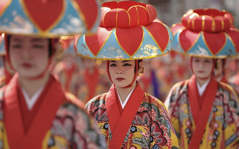 """""""Naha City. Traditional dance performers make their way down """"Kokusai St."""" (International St.) during a local festival."""""""