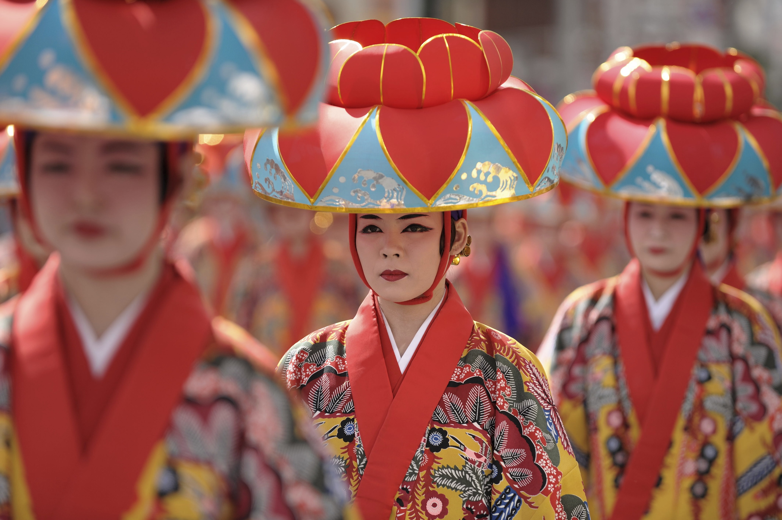 """Naha City. Traditional dance performers make their way down ""Kokusai St."" (International St.) during a local festival."""