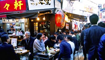 People eating and drinking in an izakaya in Ameya-yokocho, Taito-ku, Tokyo