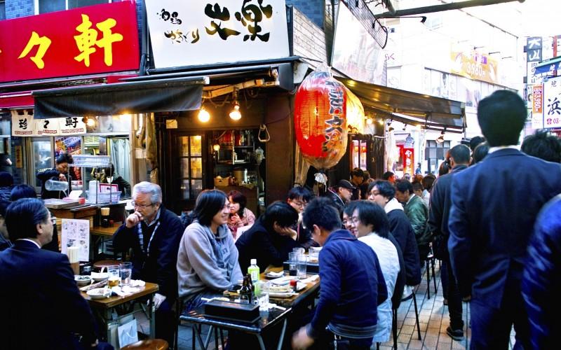 People eating and drinking in an izakaya in Ameya-yokocho, Taito-ku, Tokyo