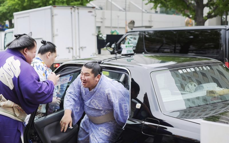 Sumo wrestlers Fujiazuma Kazuyoshi with friends during tournament season. Sumo is Japan's national sport, most professional wrestlers are foreigners