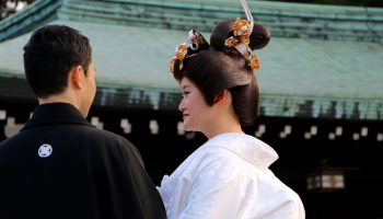 Tokyo,Japan-September 27,2015: a married couple attend Traditional Wedding ceremony at Meiji-Jingu