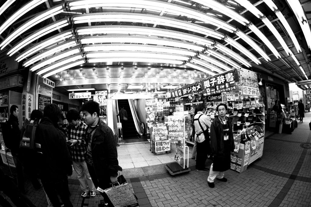 Tokyo, Japan - October 29, 2010: Vendors and shoppers in the busy Akihabara district of Tokyo, famous for the commerce in electronics