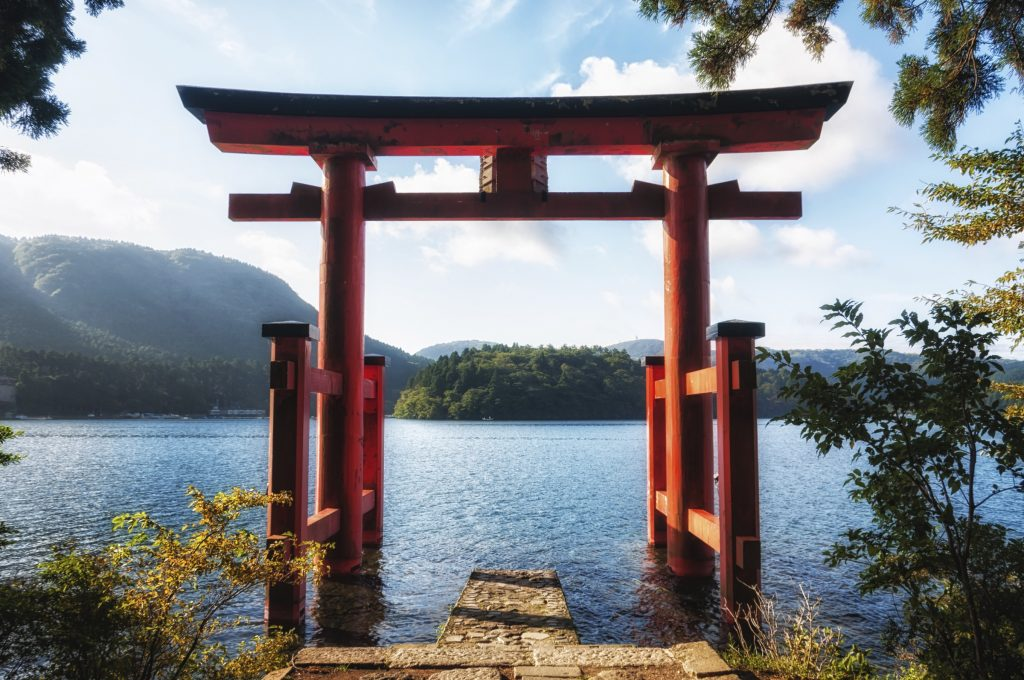 Hakone, Japan - September 21, 2013: The red torii gate which stands on the shore of Lake Ashi near Hakone Shrine. The shrine is a popular Shinto temple near Mount Fuji.