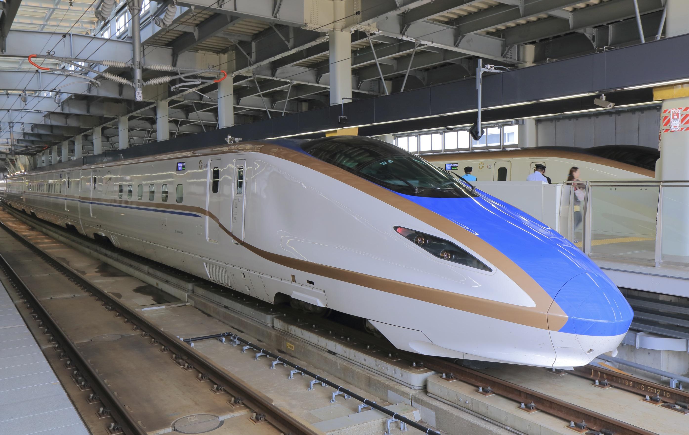 Kanazawa Japan - May 10, 2015: Modern Hokuriku Sinkansen bullet train parked at Kanazawa station in Kanazawa Japan.