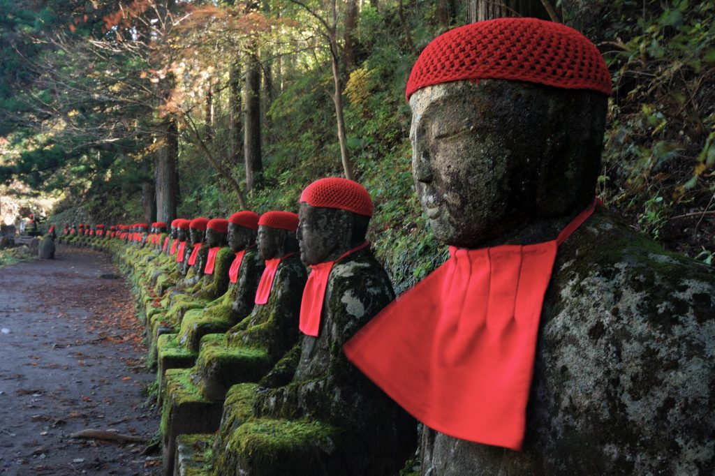 row of Japanese Jizo in Nikko, Japan; this is very famous historical place called Narabi-jizo and Bake-jizo