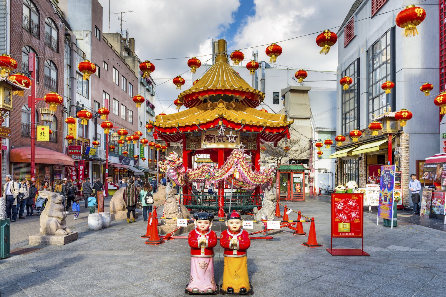 Kobe, Japan - December 17, 2015: Tourists enjoy the Nankinmachi Chinatown district of Kobe at the square and pavilion. It is one of three designated Chinatowns in Japan.